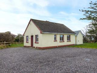 LOUGH CURRANE COTTAGE, single-storey, solid fuel stove, ample parking, on Ring