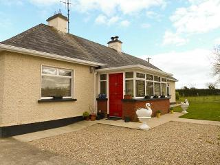 HOLLY COTTAGE, all ground floor, enclosed garden, woodburner, open fire, near