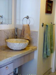 Stone vessel sink on marble counter