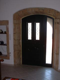 House exit view stone arcs.