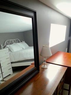 Each bedroom has a desk and mirror