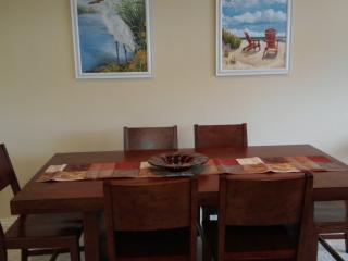 Large beautiful solid wood dining table and chairs, seating for eight.