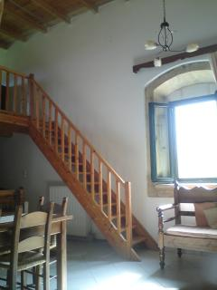 Wooden staircase to leading to bedroom loft