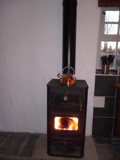 Log burning stove to keep you warm and cook your meals on.