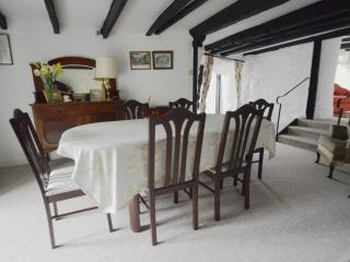 Dining room with double doors to garden, step down to kitchen