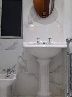 Fully tiled bathroom with bidet