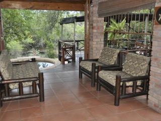 Covered veranada with comfortable deck furniture.
