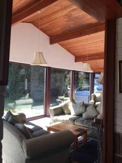 The view of the main living area. The wooden frontage and interior gives a chalet feel.