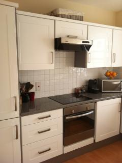 The kitchen has all the mod cons you'll need - microwave, dishwasher, oven, fridge freezer, stove