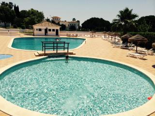 Beach and swimming pool at algarve, Armacao de Pera