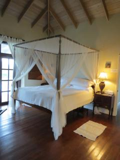 Master bedroom with giant four poster and vaulted ceilings