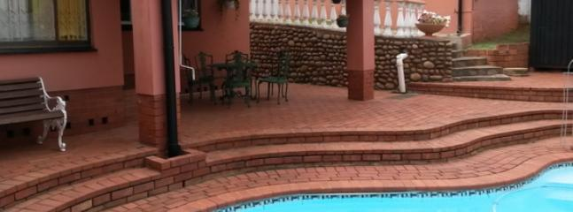 The covered patio next to the pool