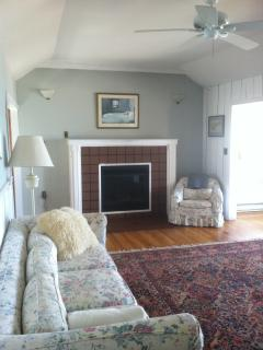 Lark's Cottage living room with gas fireplace and picture windows.