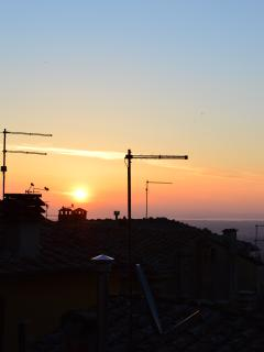 Sunrise view from living room window-roof