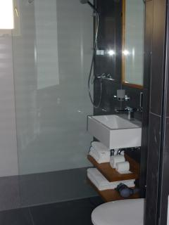 modern designed bathroom, hand made shelves and mirror from croatian acacia