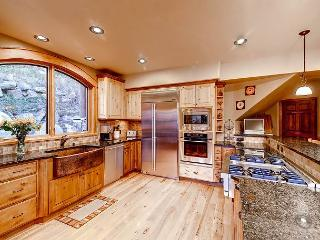 Spacious Kitchen with gas cooktop and bar seating
