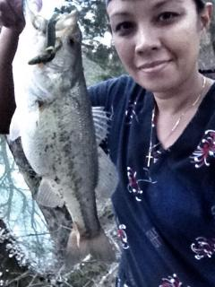 Guest excited to catch a bass from the creek!  Bring your tackle and pole & wet a hook at the creek