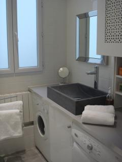 Bathroom with full-sized washing machine and separate dryer