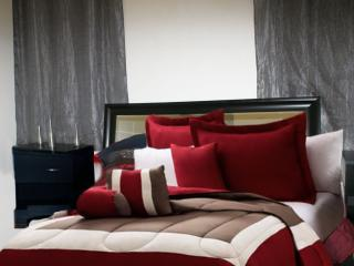 VIEW OF YOUR BEAUTIFUL BED WITH DESIGNER BEDDING SHEETS, VERY COMFORTABLE AND CLEAN.
