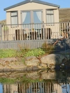 Snowdonia Retreat private decking in front of Koi Fish Pond