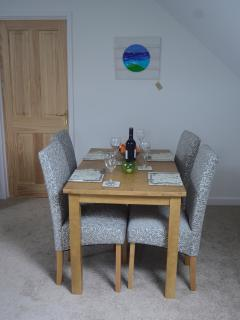 Open plan dining area with table for four