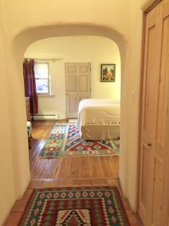 Room with comfortable pillow top matress, Kiva fireplace and flat screen TV