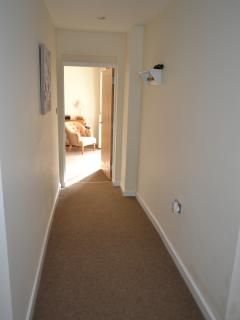 corridor from bedrooms into lounge/kitchen