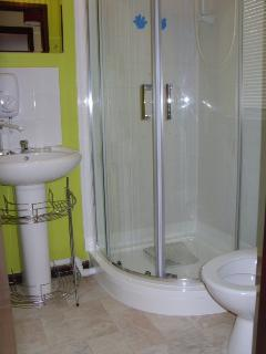 Shower room that has just had a new shower suite put in, heated towel rail for comfort.