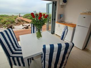 Dining area with full, uninterrupted sea views.