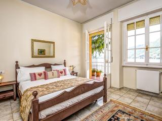 Master bedroom with French doors to the private balcony and lake views