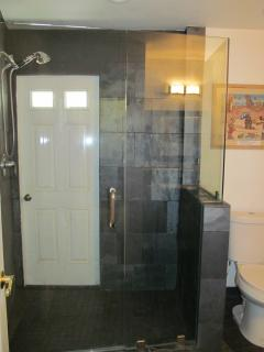 Downstairs bathroom w/exterior door to yard