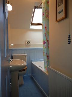The Bathroom; bath with Shower over, WC and Sink. All Towels are provided