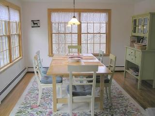 sunny dining room with seating for eight