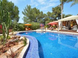 Pool surrounded by gardens and chill out areas