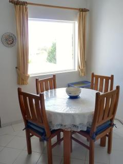 Inside dining area with hatchway to kitchen