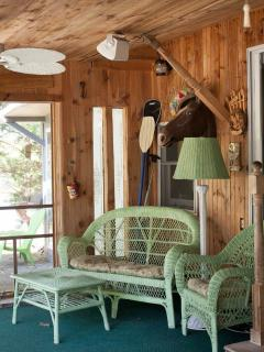 Screened porch with table for meals .Sit in morning drink coffee and listen to birds.
