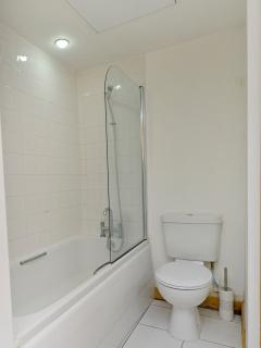 The large family bathroom with bath and shower facilities