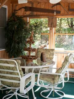 Screened porch with ceiling fans