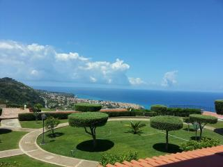 Mature gardens of Marasusa overlooking the sea
