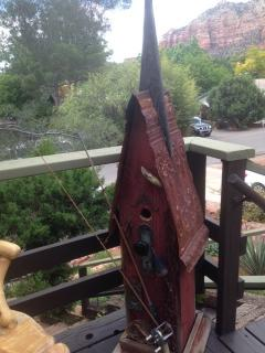 A fun birdhouse on the deck that was purchased at our local thriftstore -