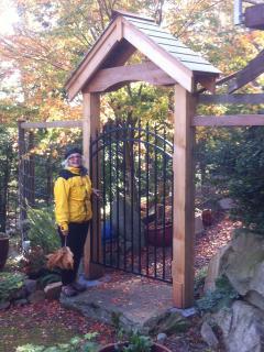 Host Linda at  entrance to main house,