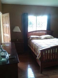 Bedroom with door to porch
