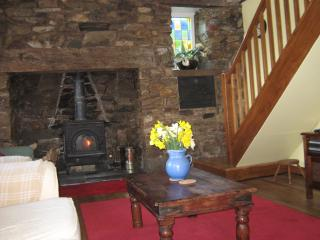 LIVING ROOM  WITH LOG BURNER AND STAIRS UP TO GALLERY BEDROOM