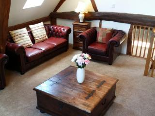upstairs sitting room with original beams