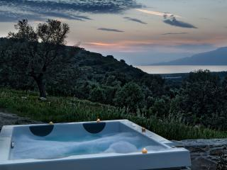 the luxury outdoor heated spa, made by jakuzzi, with a breathtaking view to sea and Psiloritis