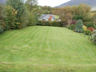 The property has its own large lawned garden to the front.