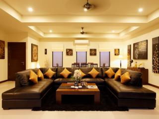 Spacious Living room with large leather sofa and flat screen TV, DVD Player and cable channels