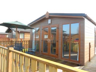 Lodge at Borwick with leisure facilities, ideal for families, pets considered.