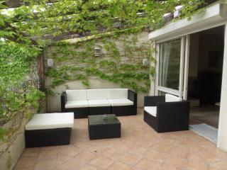 Relaxed seating area on back terrace - great in the day and night