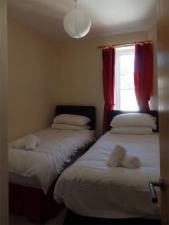 Second bedroom - two full-size single beds.